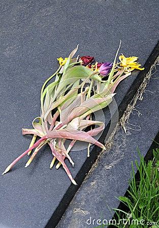 Wilted flowers on gravestone