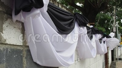 Wind blowing white and black cloth decorated wall stock video