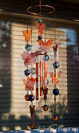 Wind chime in front of window