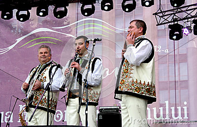 Wind instruments performers have fun playing music in the Moldovan national costumes Editorial Image