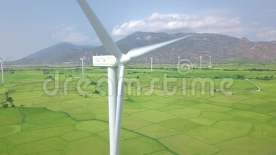 Wind power turbines aerial landscape. Windmill turbine generating clean renewable energy in green agricultural field. Drone view. Wind energy station. Ecology stock footage