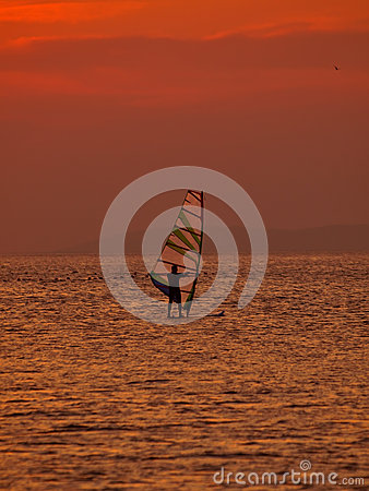 Wind surfer at sunset