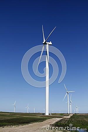 Wind turbine on dirt road