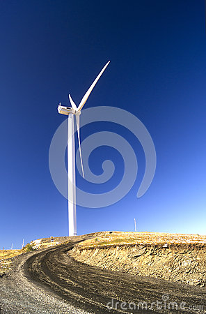 Wind turbine with landscape and blue sky
