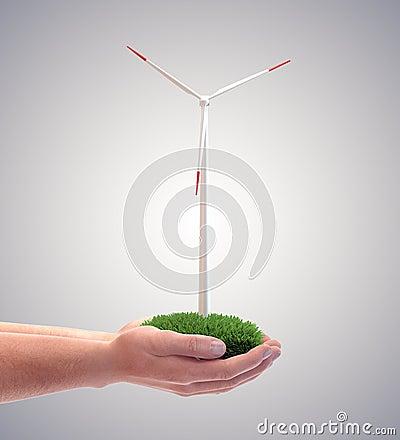 Wind turbine in a man s hand