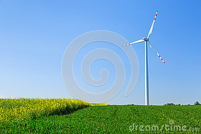 Wind turbine over blue sky