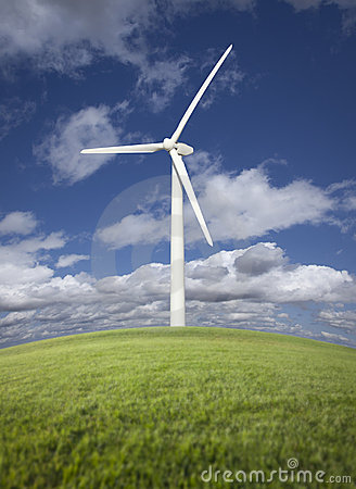 Wind Turbine Over Grass Field, Sky and Clouds