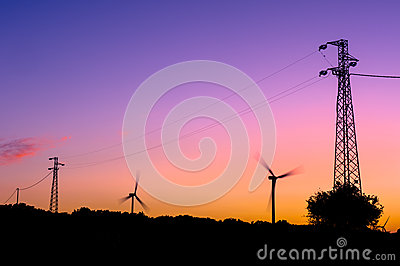 Wind turbines and electricity pylons silhouettes