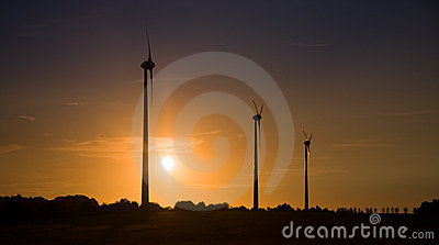 Wind turbines over sunset
