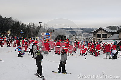 WINDHAM DECEMBER 19 - Skiing and Riding Santas for charity at Windham Mountain Editorial Stock Photo