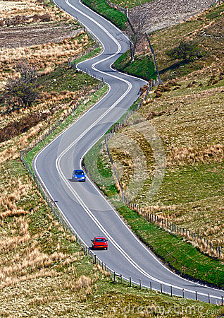 Winding road with cars