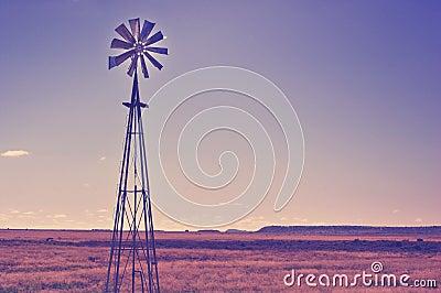 Windmill in the arid landscape