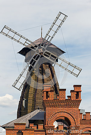 A windmill and a brick tower