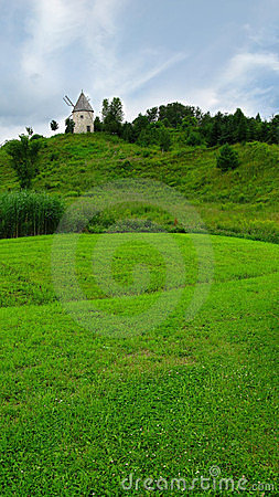Windmill on a green hilltop