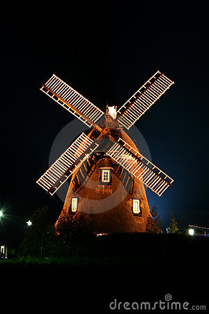 Windmill illuminated at Night.
