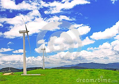 Windmill on  a plain  under blue