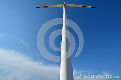 Windmill power generator under blue sky