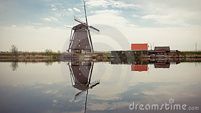 Windmill reflecting on water