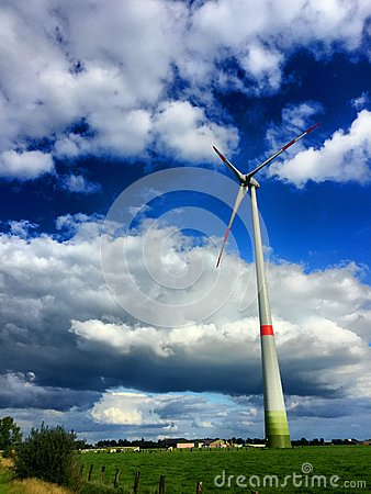 Windmill for renewable electric energy production Stock Photo