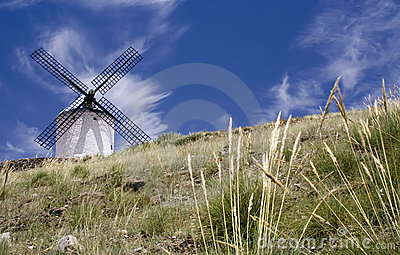 Windmill Standing in a Field