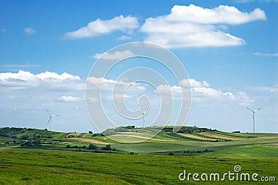 Windmills between farm field