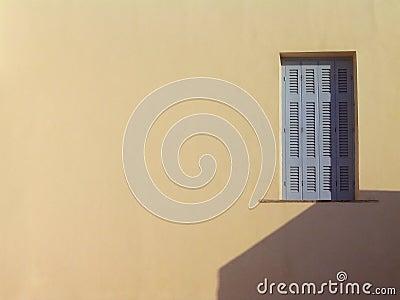 Window on beige wall.  Santorini, Greece
