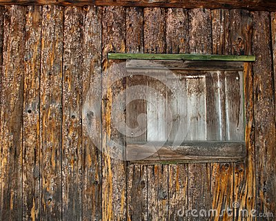Window of a Boarded up log cabin