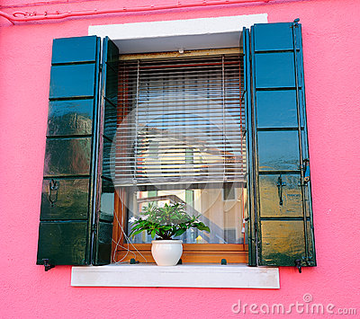 Window of a bright pink house
