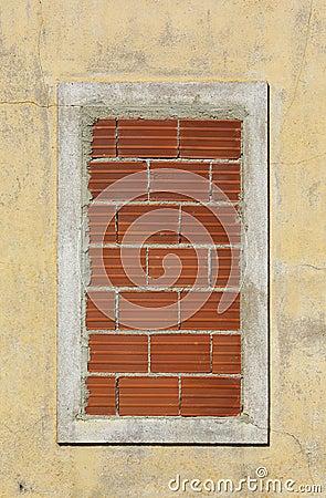 Window closed with bricks