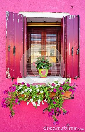 Window of a crimson house
