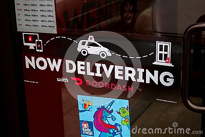 DoorDash and Wendy`s delivery sign Editorial Stock Photo