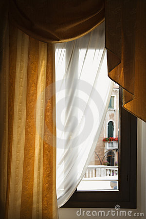 Window with drapes in Italy.