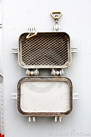 Window - the grate slatted porthole at a military