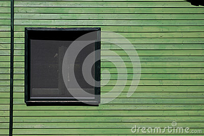Window in green wooden wall