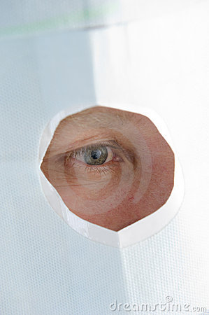 Window in a mask for treatment of an eye