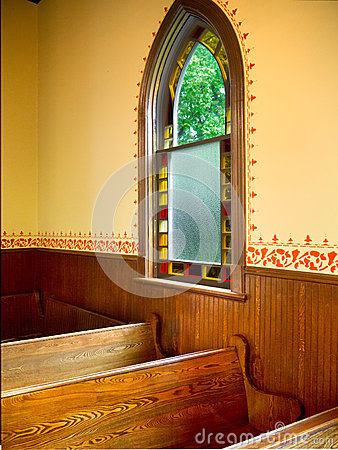 Window next to pews in Simple old Church