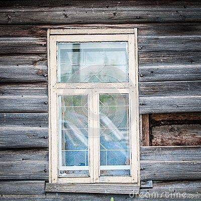 Window of old traditional russian wooden house.