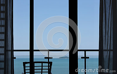 Window overlooking blue sea