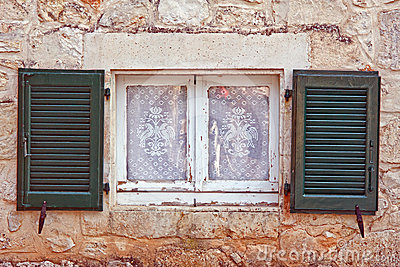 Window with shutter and net curtain
