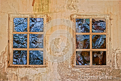 Window with view to rocks in a old building. HDR picture