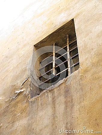 Window in the wall barred.