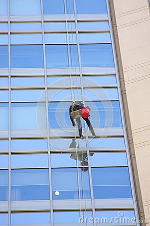 Window washer and a glass wall