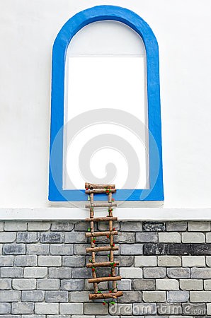 Window with white copyspace and rope ladder