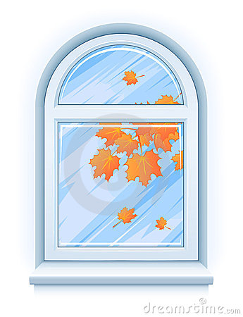 Window with yellow autumn leaves