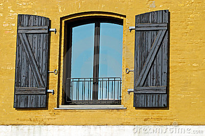 Window in a yellow wall