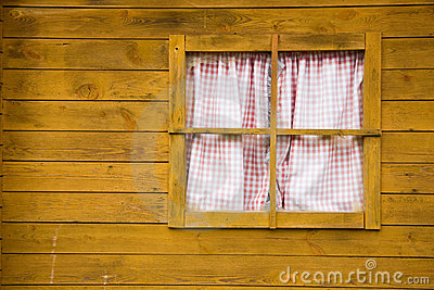 Window on yellow wooden wall