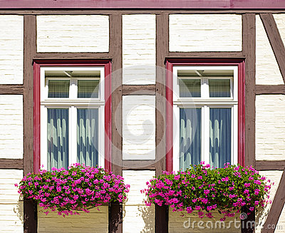 Windows with flower boxes at frame-work house