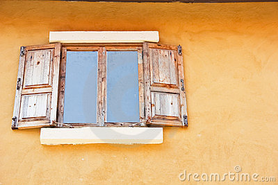 Windows made ​​of wood, the yellow background