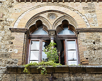 Windows on medieval brick wall