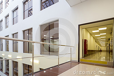 The windows of offices and a long corridor in modern beautiful Business Center Editorial Stock Image